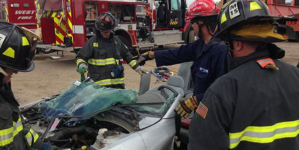 Group of firefighters training in auto extrication