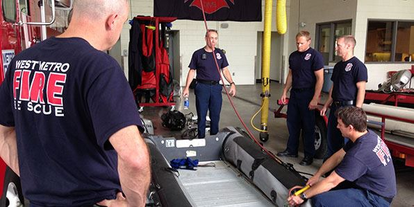 West Metro dive team getting equipment ready during potential floods.