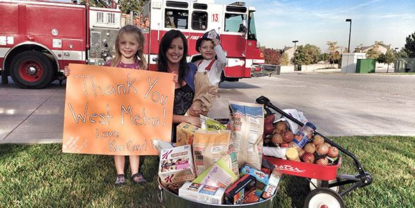A group of residents from the Ken Caryl Valley neighborhood bring thank you gifts to West Metro fire