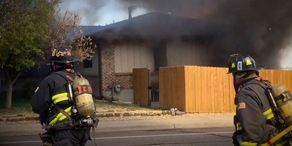 Two firefighters responding to house fire