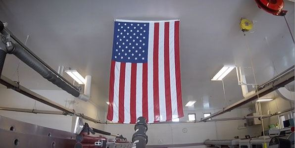 American flag hanging in the apparatus bay at Station 13
